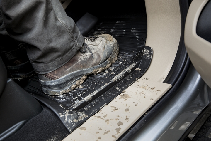 Muddy boot on all weather floor mats in front seating of 2021 Ford Super Duty Chassis Cab