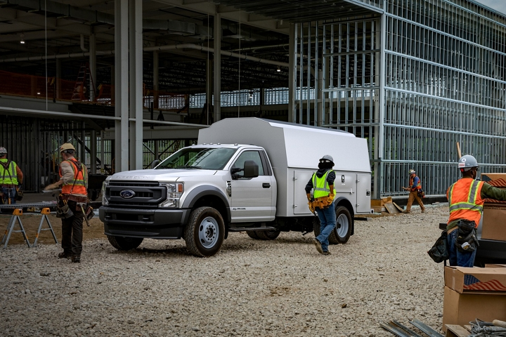 Workers near 2021 Ford Super Duty Chassis Cab F 5 50 X L in Oxford White with upfit at construction site