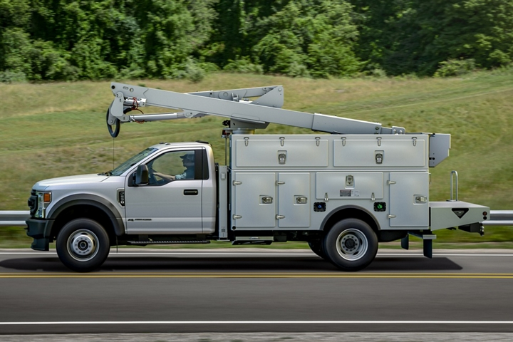 2021 Ford Super Duty Chassis Cab F 5 50 X L with upfit being driven on roadside view