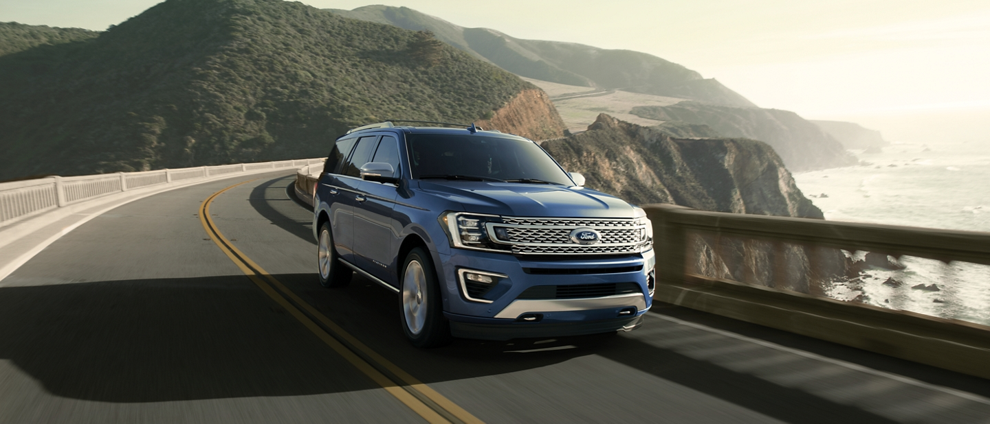2021 Ford Expedition shown driving on a city highway