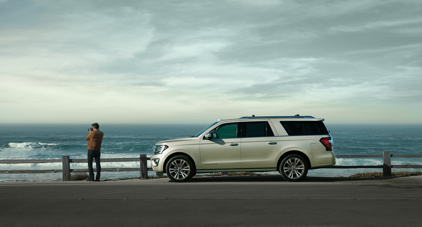 2021 Ford Expedition shown parked next to the ocean