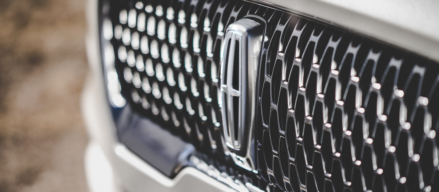 The grille of the Lincoln Aviator Reserve model is shown which uses an eye catching repeated field of Lincoln Star logo shapes